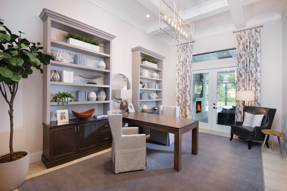 The study, topped with a coffered beam ceiling and crown molding, is a quiet place to read or accomplish some work. Elegant built-ins provide plenty of attractive storage space, and a cleverly designed desk allows for multiple workstations. On the opposite wall, a wet bar with room for a wine reserve reminds you that it's always five o'clock somewhere.