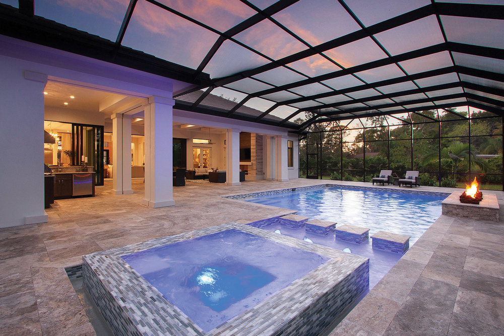 The pool uses less chlorine thanks to a salt water generator system. The raised spa and sun shelf are accented by the modern fire feature. The panoramic panels for the screen enclosure create an unobstructed view of the yard and private pond with spectacular water fountain. Thanks to the 1.5-acre lot which provides plenty of lawn space, an outdoor fire pit sits just beyond the screen enclosure. This is the perfect spot to roast marshmallows on the occasionally cold Florida winter night, while the water feature provides relaxing ambient noise.