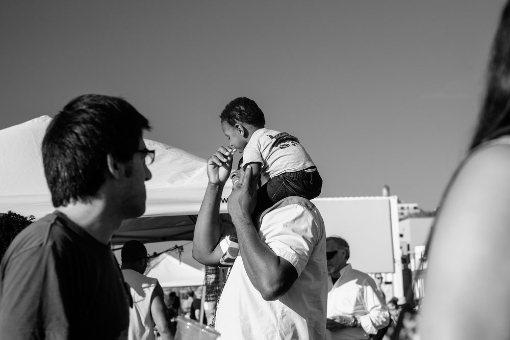 Father-and-Son-Eat-French-Fries-Photoville-BW-(Large).jpg