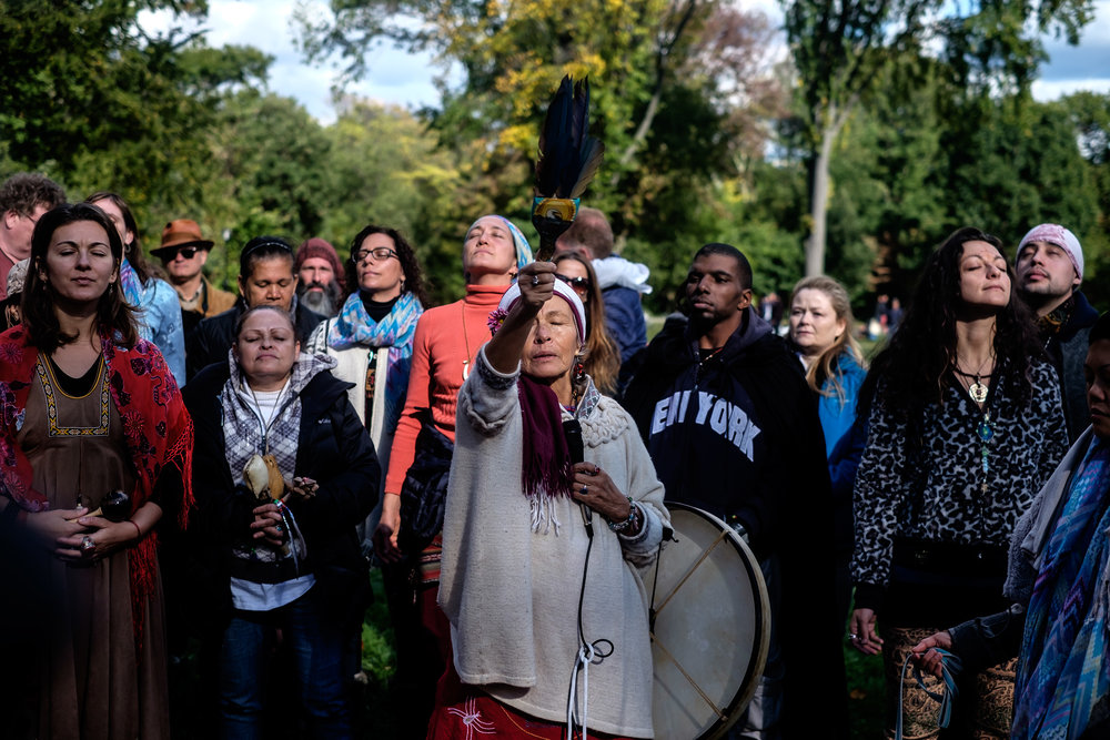 A woman leads a spiritual meditation practice during the 17th Annual Shamanic Gathering in Central Park, NY.