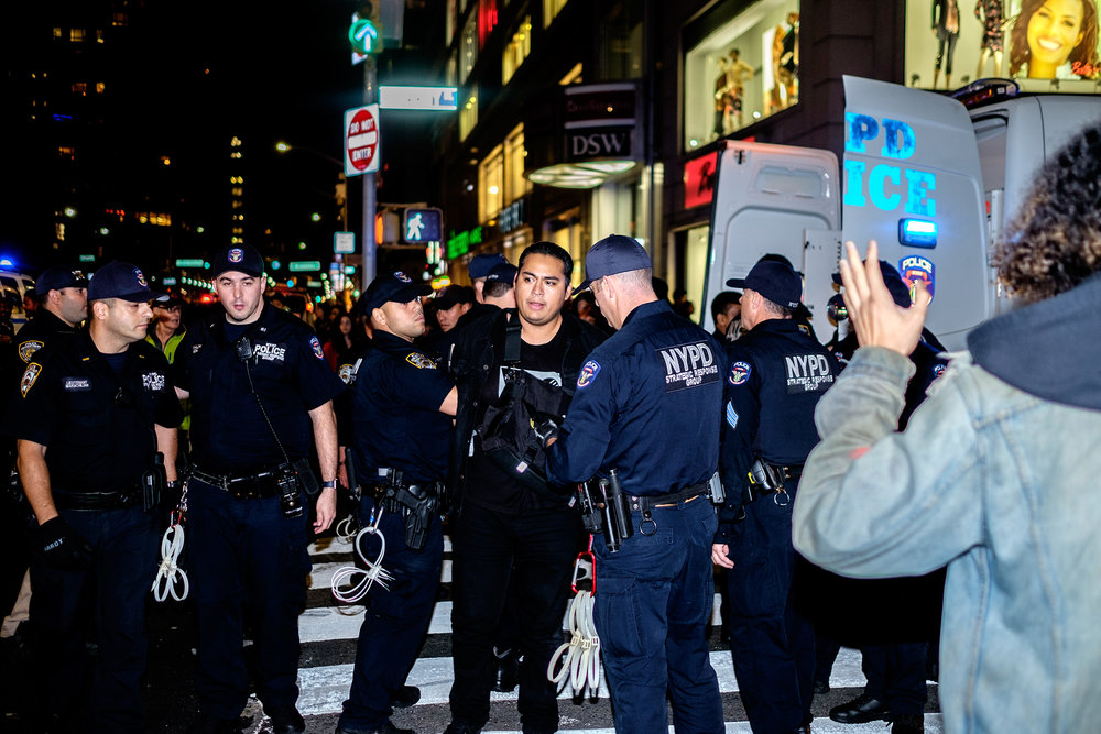 A man is arrested for disorderly conduct during a protest for Botham Jean in New York City.