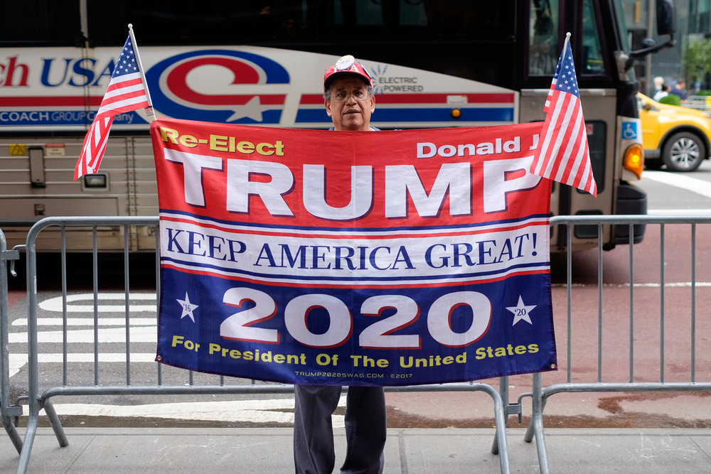 A supporter of President Donald Trump is seen across the street from Trump Towers on 5th Avenue before the start of an anti-Kavanaugh in New York City.