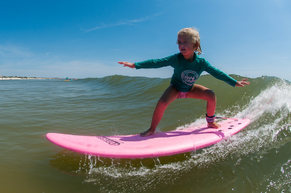 This is Maisey (5).  Last week was her first ever week of surf camp with us.  Her big brother Crockett (7) has done several weeks in the past couple years, and her biggest brother Fitch (16) is one of our instructors.