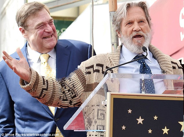 Jeff Bridges greets fans at a ceremony to honour his The Big Lebowski co-star John Goodman on the Hollywood Walk of Fame in 2017. Pot and the movies have been a long-time pairing, from 1936's propaganda film Reefer Madness to contemporary onscreen stoners like Vancouver's Seth Rogen. (Chris Pizzello/Associated Press)