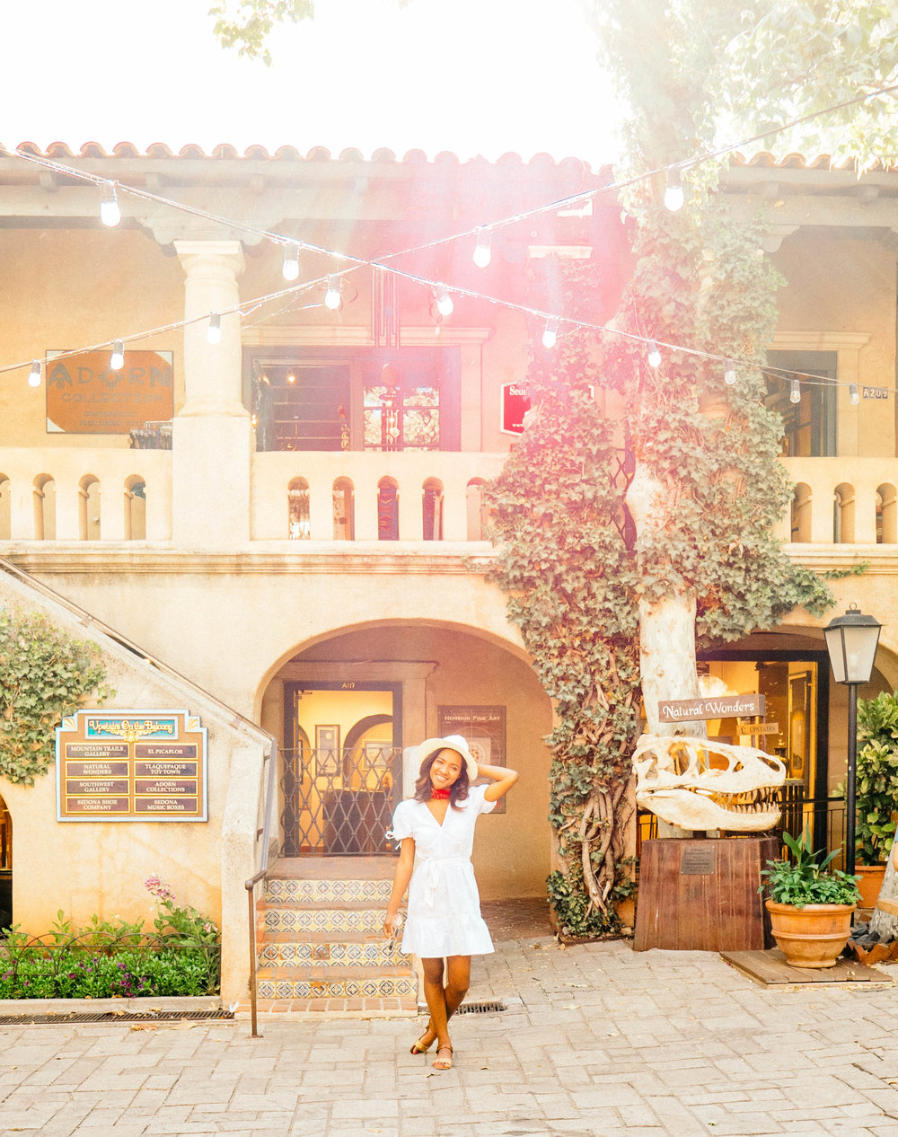 """Back with another Sedona post! This time, we explored the really nice shops of the Tlaquepaque Arts & Crafts Village. Try saying """"Tlaquepaque"""" a couple of times! It was hard for me to just say it once! I had been to these shops once before, on a girls trip back in January. But this time the weather was much warmer and all of the flowers were in bloom. There were roses everywhere! And let me just say that as soon as I walked inside the shopping area, it felt as if I was transported back to Rome...the shopping village has a very """"Tuscan"""" feel and reminded me of Italy. It was truly beautiful. We ate at Pisa Lisa first, which was just down the road and quite possibly one of my favorite pizza spots I've EVER been to (apart from the pizzarias in Italy). And then we went to the shops to """"walk off our pizza"""" and we enjoyed a drink at the """"Oak Creek Brewery"""" which is a really cool local brewery with great drinks and beer! If you ever go to Sedona, you have to go to Tlaquepaque and make a stop at Pisa Lisa for pizza and Oak Creek Brewery! Till next time! *kisses* - Cristal"""