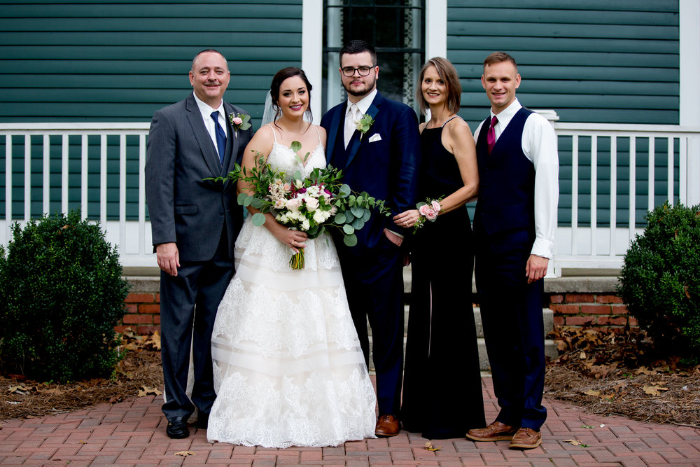 This is Megan on her wedding day with her family! Photo by Taken by Tate.