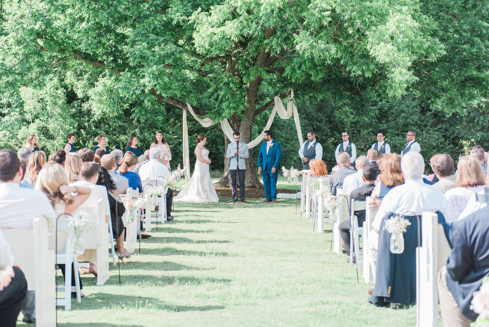 Outdoor wedding ceremony at Pepper Sprout Barn, picture by Holly Von Laken