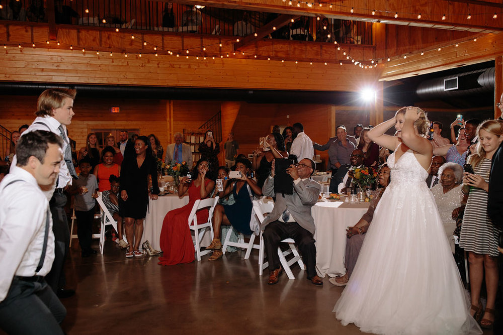 The bride's reaction to her family surprising everyone with a dance!