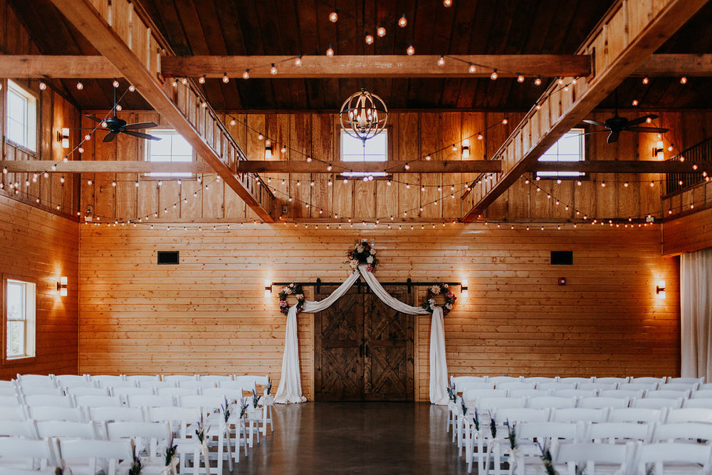 Inside wedding ceremony with standard seating. pc Brooke Miller Photography