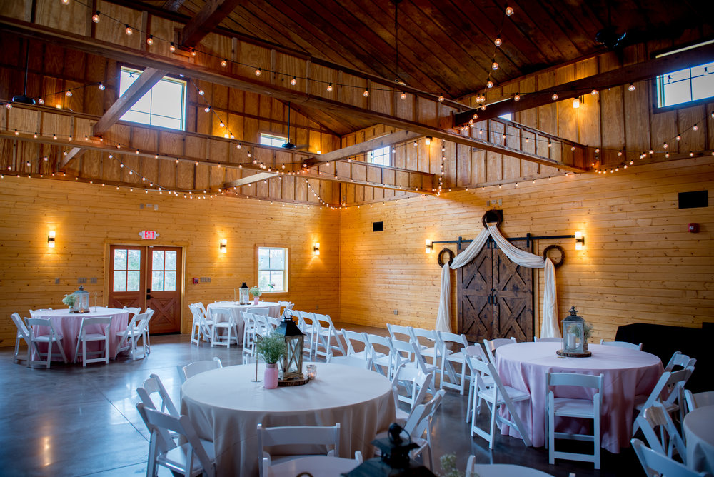 indoor wedding ceremony with reception-style seating. pc Brian Dean Photography