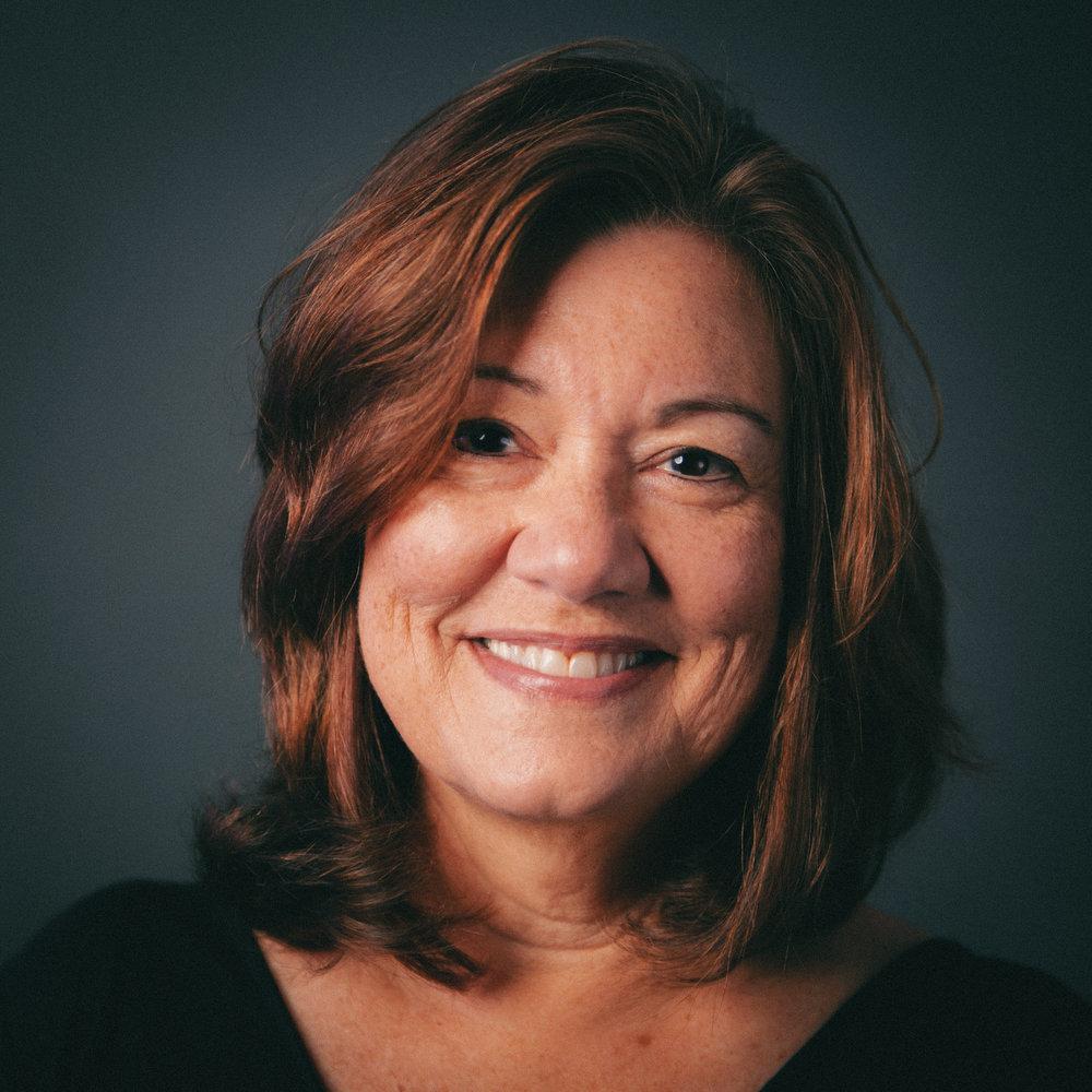 Zenia Robertson  Mort Associate Director