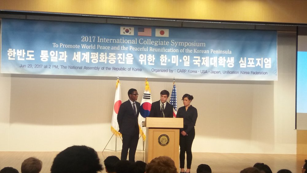 (Left to Right) Jermaine Bishop Jr., Joshua Holmes, and Naomi Froehlich of CARP America speak at the South Korean Congress Building.