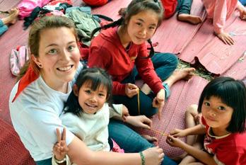 unificationist_gpa_felicia_bratti_with_thailand_kids.jpg