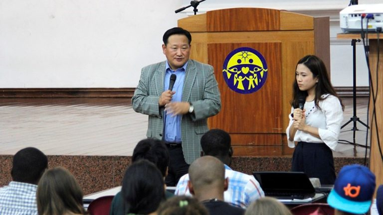 Rev. Shin Dong Mo giving encouraging remarks to the participants