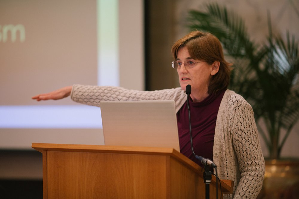 "Christine Froehlich gave a presentation on ""A History of Feminism."""