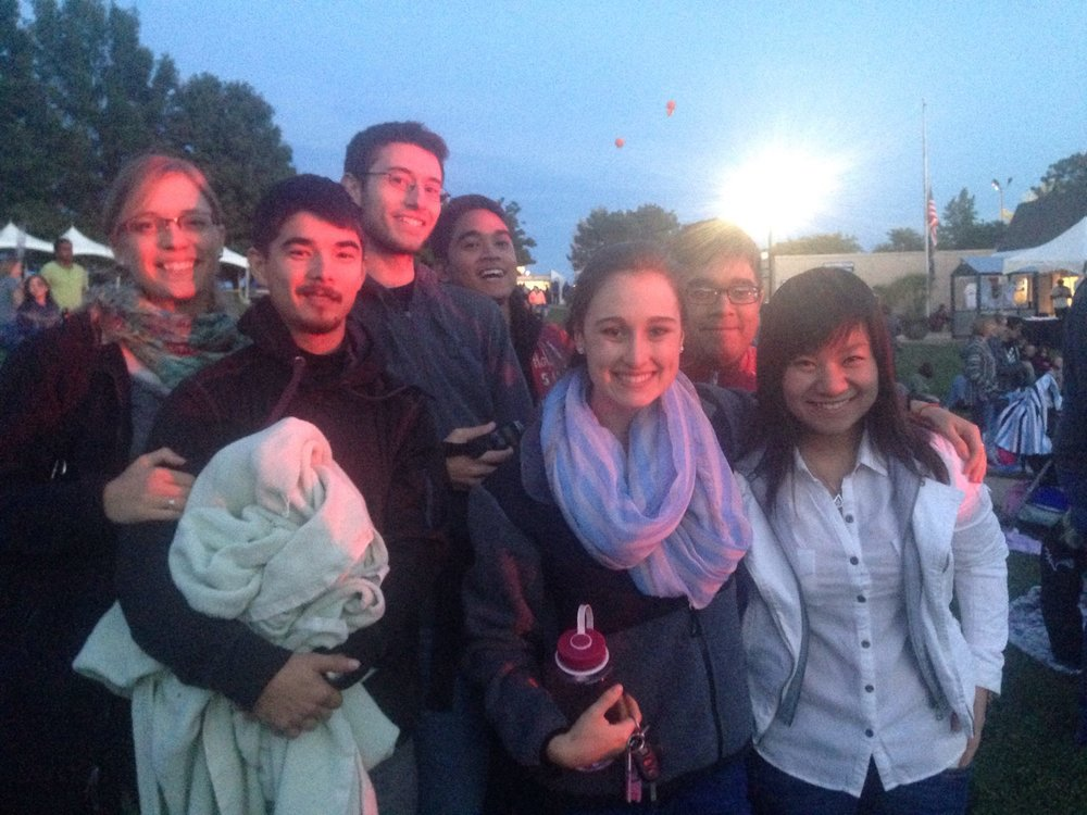 A young adult outing at an outdoor concert featuring Carly Rae Jepsen.