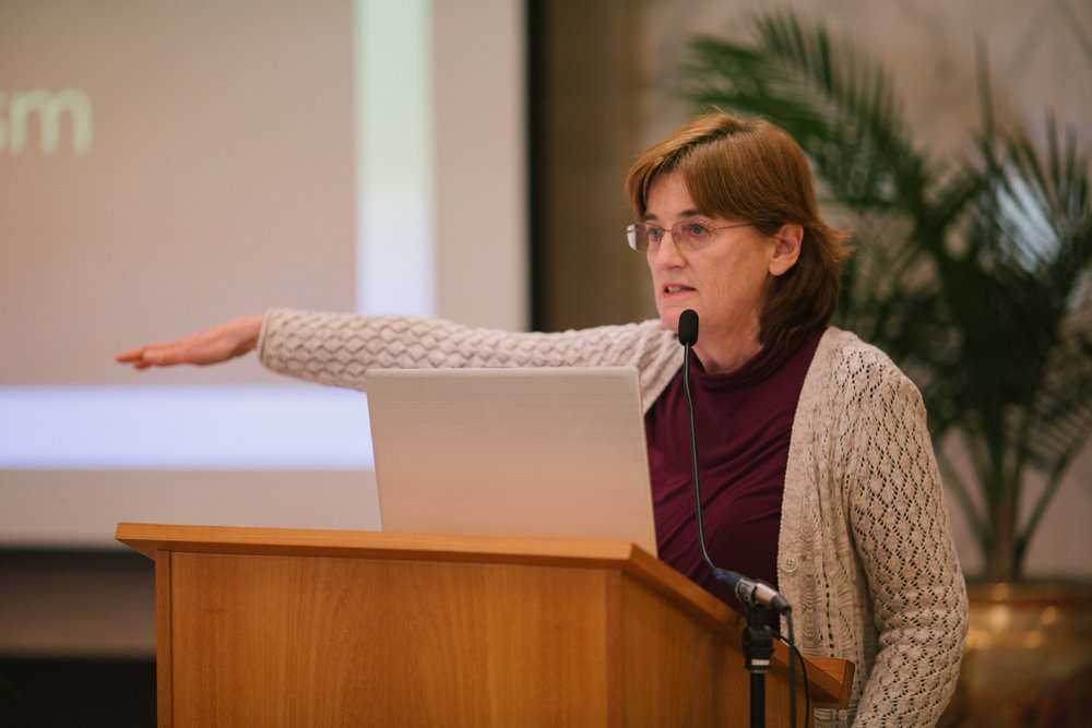 "Christine giving a presenattion on ""A History of Feminism"" at a    Culture War Seminar   ."