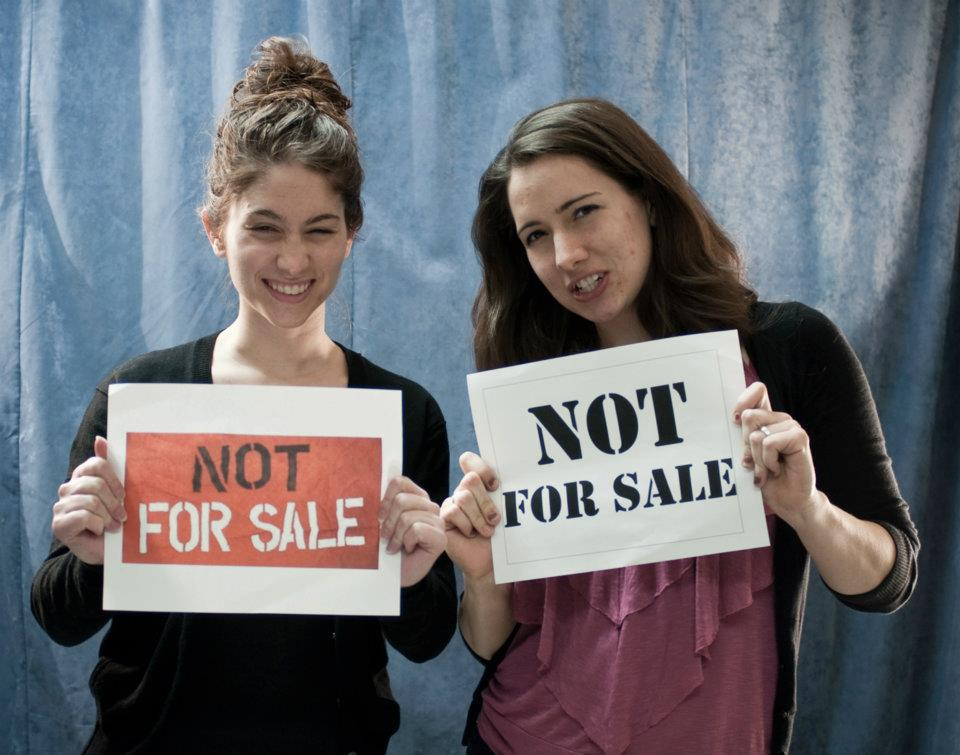 Teresa and a college classmate joining in on a social media campaign against human trafficking in 2012.