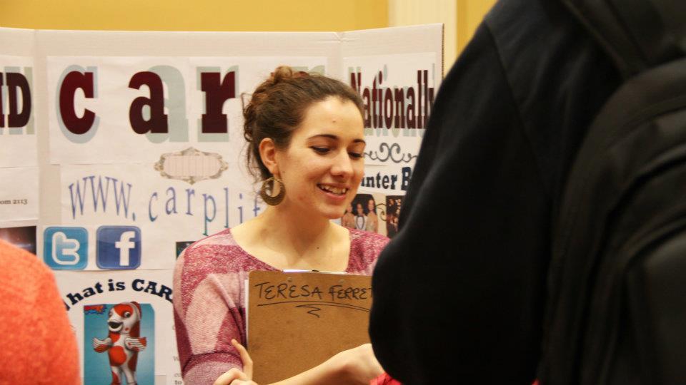 Teresa at a CARP stand talking with a student at the club fair at UMD.