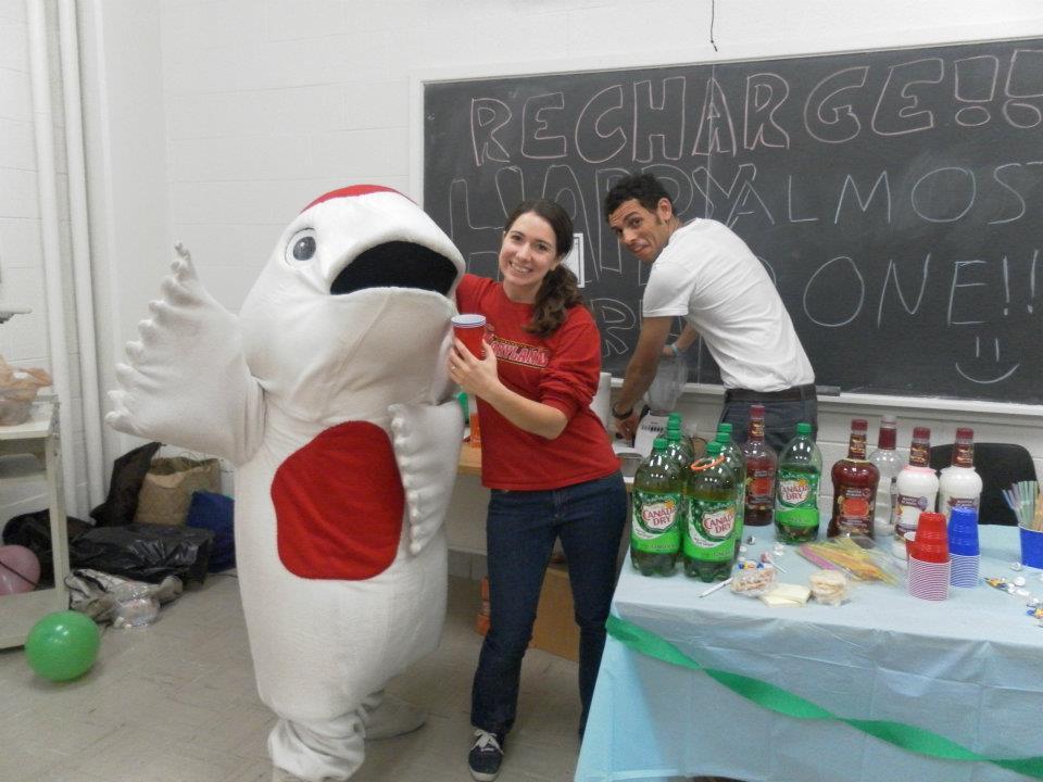 Teresa posing with the CARP mascot, Mr. The Fish, with a fellow CARP member.