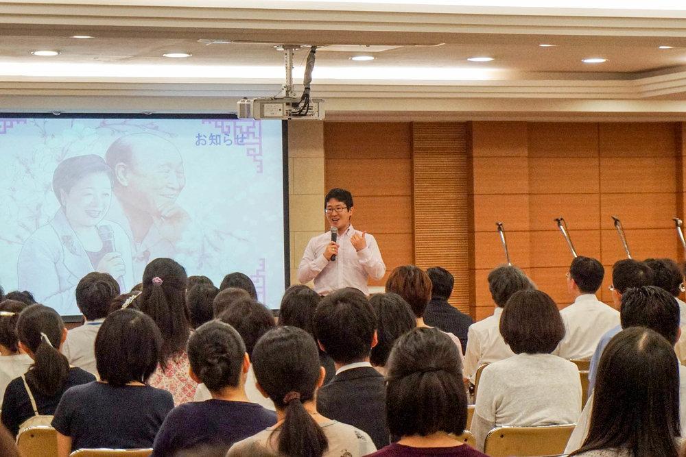 Naokimi giving a Sunday Service sermon