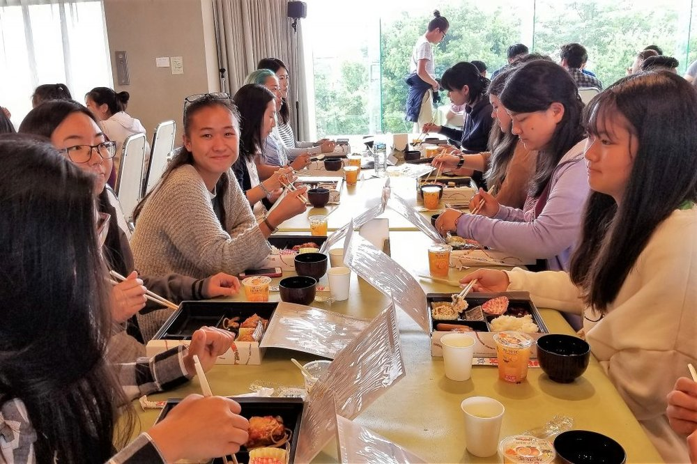 American students enjoying a Japanese bento box lunch