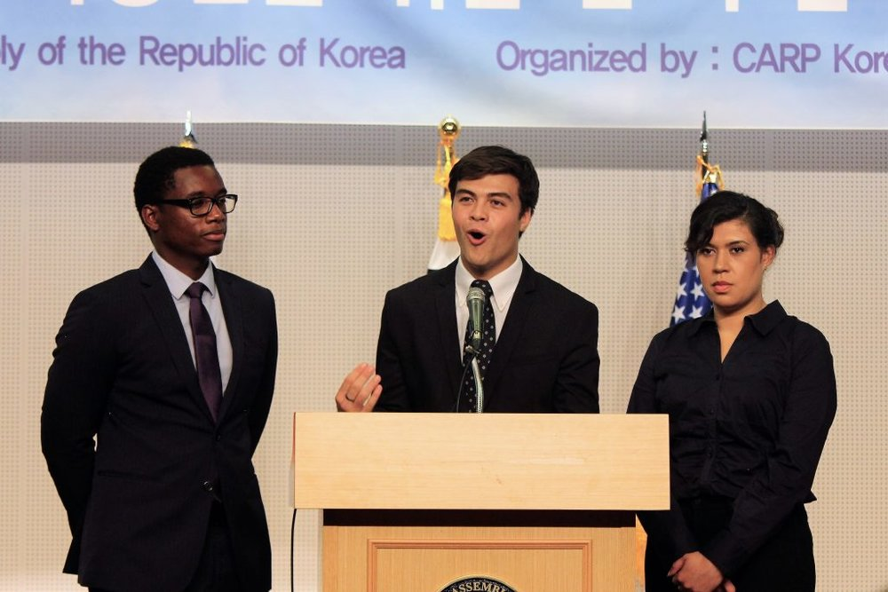 CARP America representatives giving a speech on the importance of North and South Korea Reunification