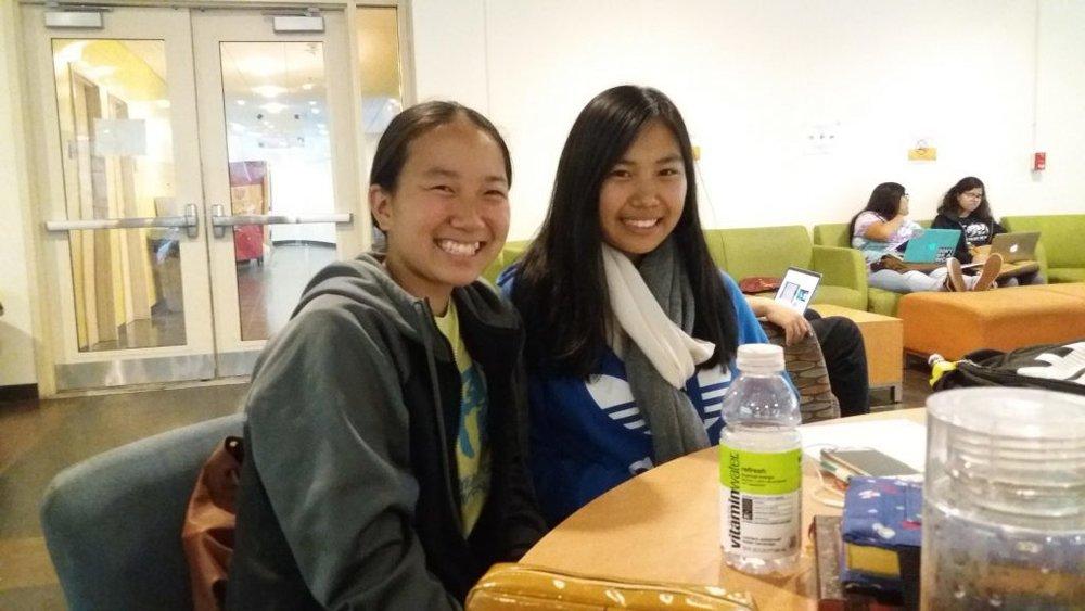 (L to R) Kayun Hiraki and Naomi Kotani learning from CARP members at Pasadena City College (PCC).