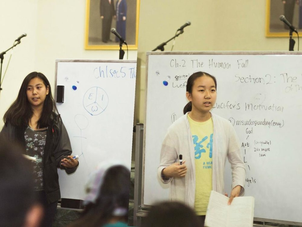 (L to R) Naomi Kotani and Kayun Hiraki learn how to share Unification Principles.
