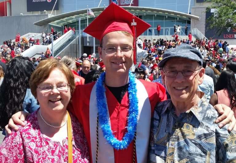 Jinil and his parents during graduation at UNLV.