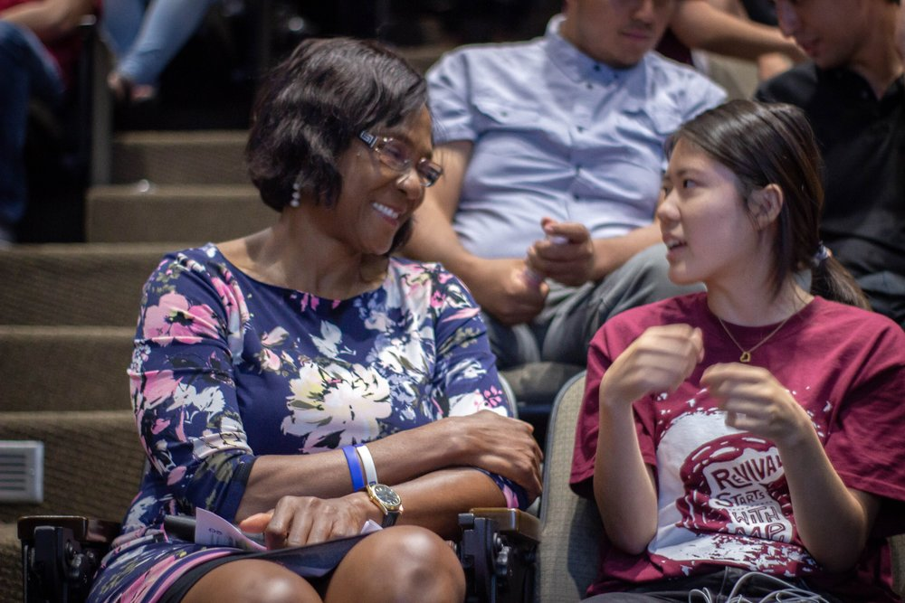 Professor Grace Apiafi (left), CARP PCC advisor, discusses her thoughts with Madoka Tsuchihara (right), CARP PCC President.