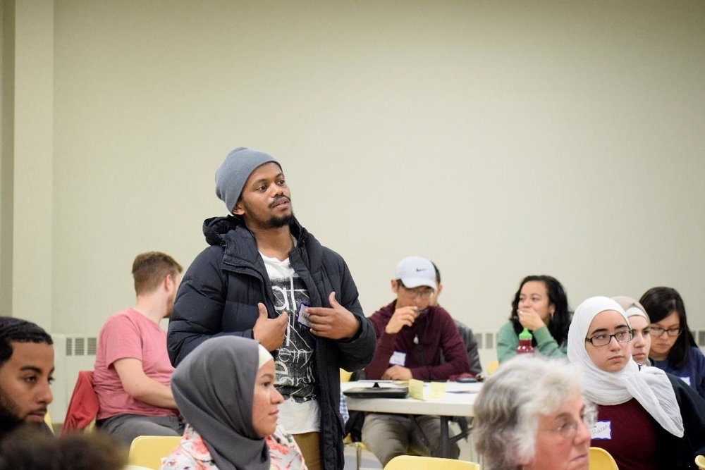 A student asks the panel about spirit world during question and answer.