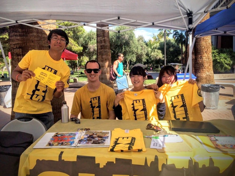 Passing out flyers and sharing about Shine City Project at the UNLV Involvment Fair in September 2015 with volunteers and John Everett, a student officer for SCP.