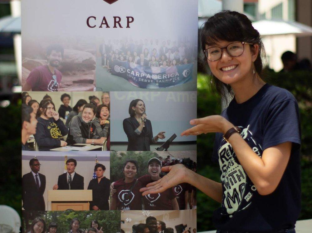 Satomi Kikuchi reps CARP during Club Fair on CSULA campus.