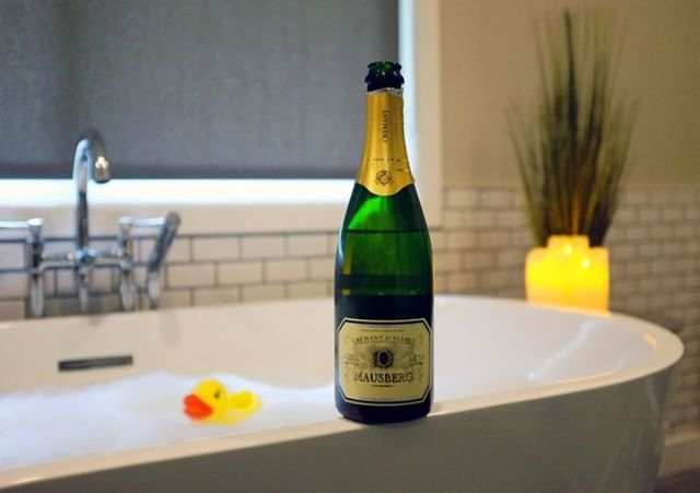 Pair bubbles with bubbly to make today extra relaxing. Crémant d'Alsace is elegant and affordable, fitting perfectly with your self-care routine 🍾⠀ -⠀ -⠀ -⠀ -⠀ #DrinkAlsace #Alsace #WinesofAlsace #Alsatianwine #France #NYC #frenchwine #wine #winelover #bubblebath #selfcare #bath #rubberduck #bath #saturday #relax #relaxation #beauty #wellness #love #winelovers #winesofinstagram #cremant #sparklingwine #bubbly #sparkling #bubbles #candles #moody #lifestyle