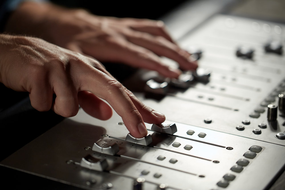 hands-on-mixing-console-in-music-recording-studio-PKNPFBX.jpg