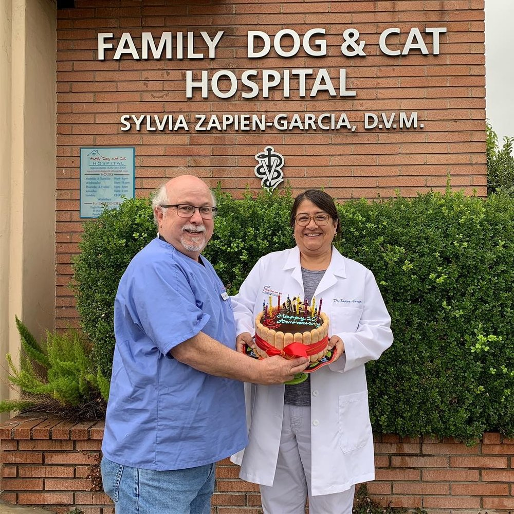 David and Dr. Garcia Celebrating 10 Years of owning Family Dog and Cat Hospital.