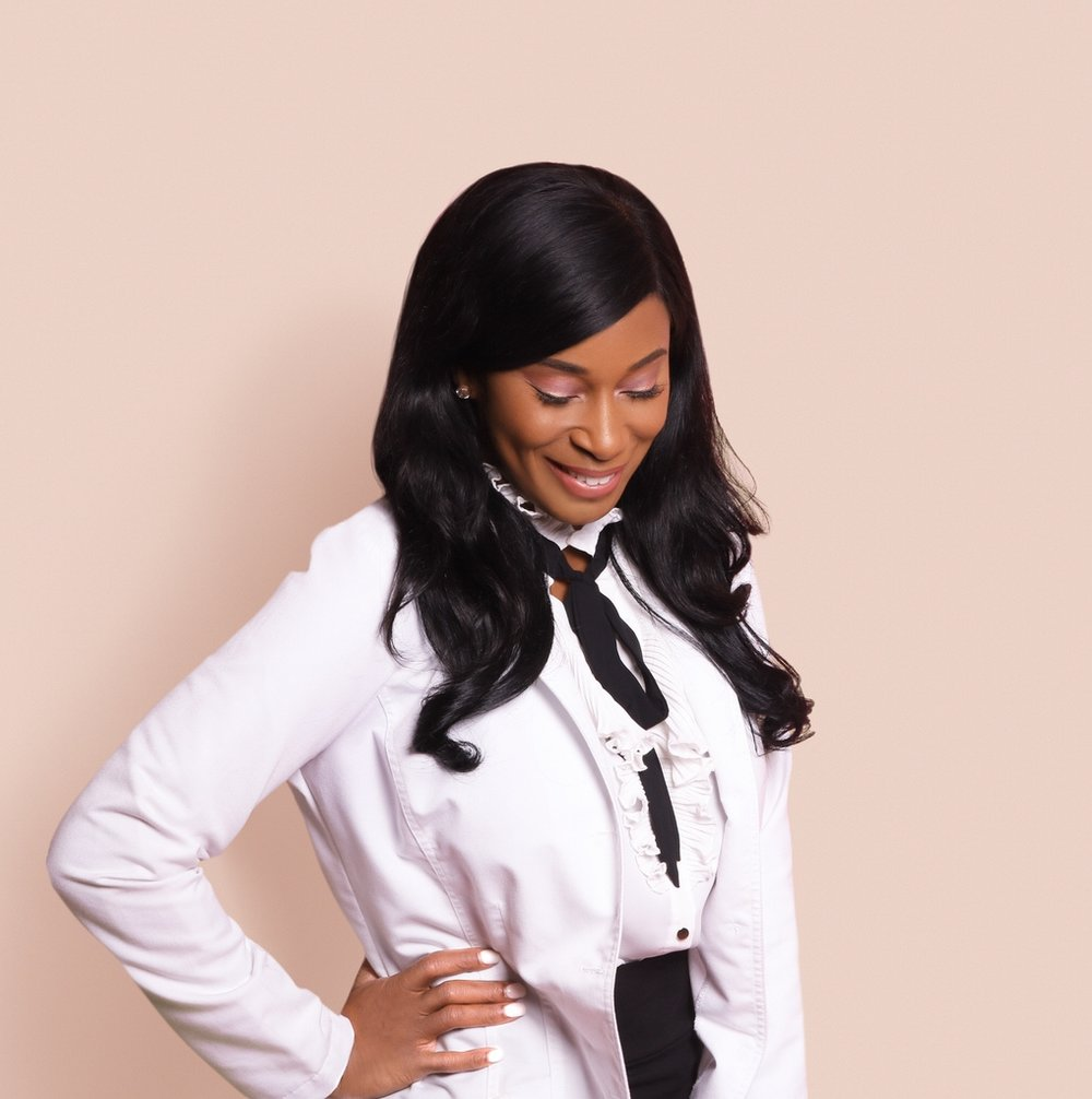African-American woman in white lab coat, white blouse and black skirt, pink background.jpg