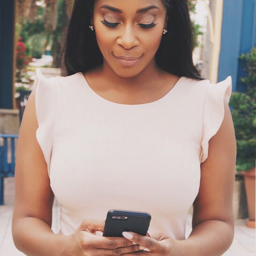 African-American Woman in Pink Dress with Cell Phone.JPG