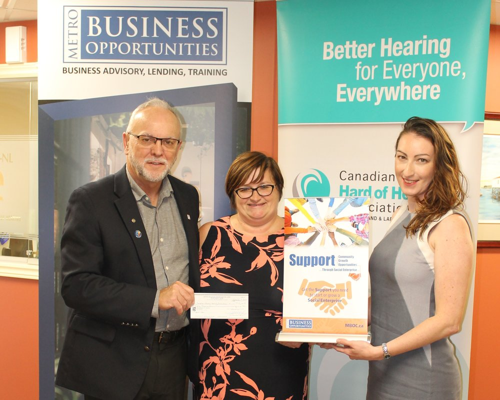 Pictured accepting their  Support  loan from Bernadette Coady, Social Enterprise Coordinator at MBO (Centre) are Leon Mills, Executive Director with CHHA-NL (Left), and Alison Butler, Coordinator of Education and Awareness with CHHA-NL (Right).