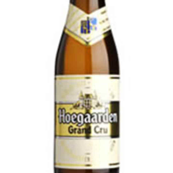 GRAND CRU   8.5% abv   One of the best Hoegaardens. Pouring cloudy orange, almost golden in colour. Flavoured with Curacao Orange and coriander (like the original Hoegaarden), it has a deliciously complex, sweet/bitter taste with subtle and citrus notes.