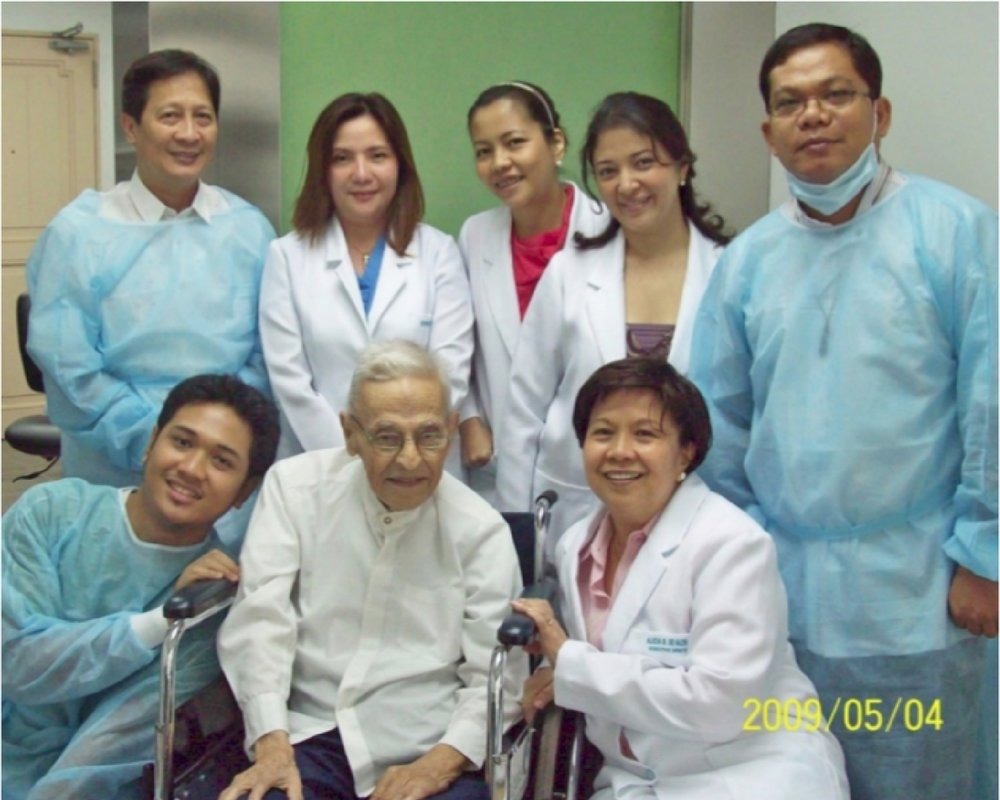 Father Aveni and Father Jessie with clinic staff in 2009