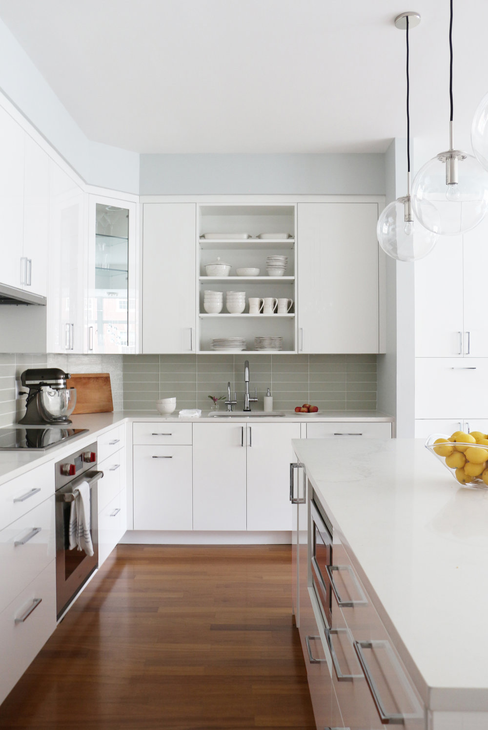 A FRESH TAKE ON AN OUTDATED KITCHEN  - Trisha and Adam were over their all-wood and granite kitchen and wanted something light, bright and modern.