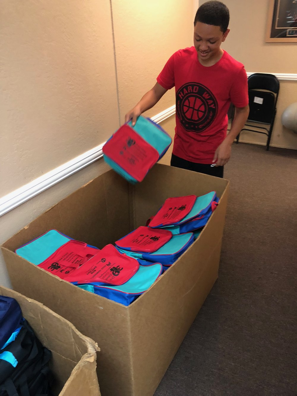 Knit caps (beenies), scarves, gloves, and socks are bagged on their way to local shelters to be distributed to people in need. Our participants are involved in the process from start to finish.