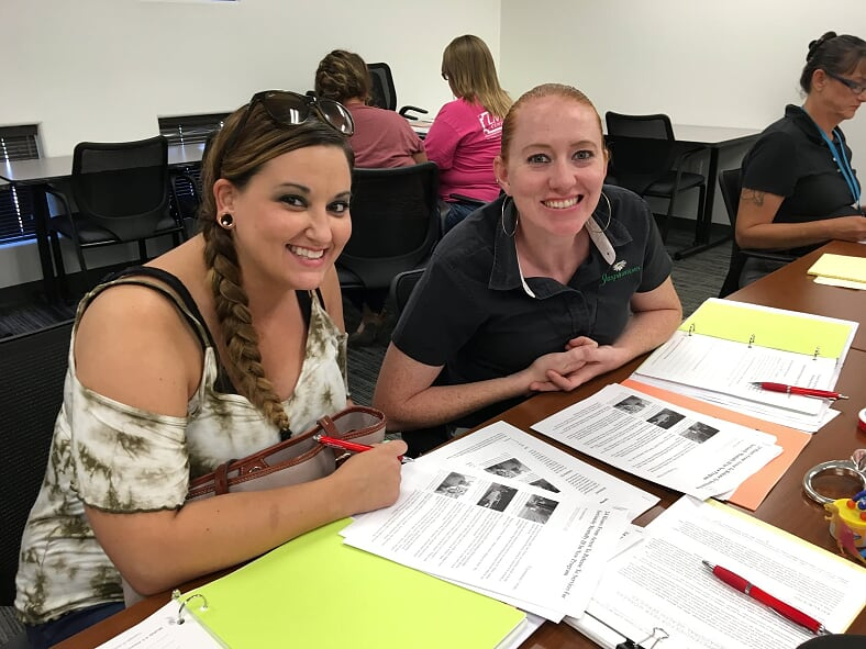 Brooke (NAZCARE) and Hollie (TLCR) prepare their presentation.