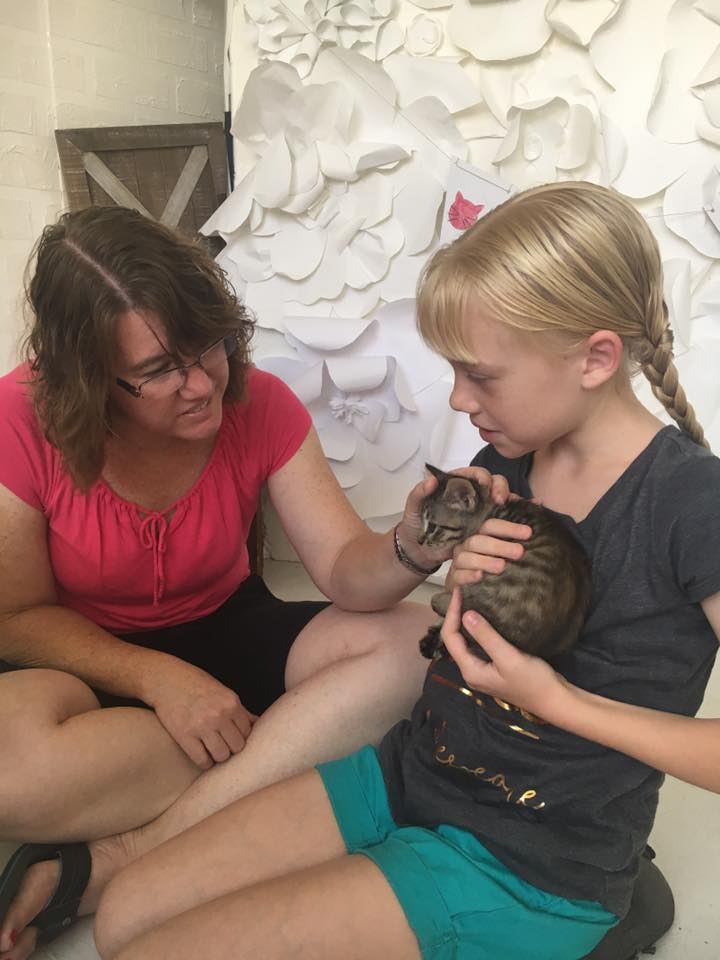 mom-daughter-cuddling-kitten-party-redlands-foster-cats.jpg