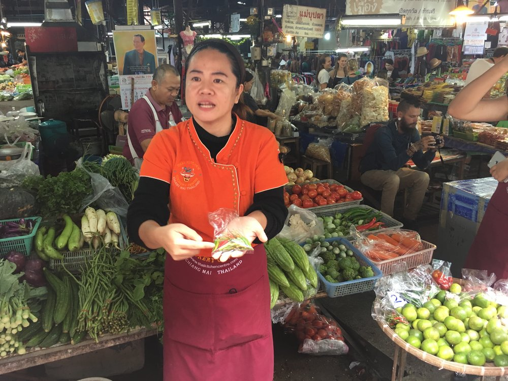 Our cooking instructor. She took us to the local mart and explained many of the common foods and ingredients they use in Thailand.