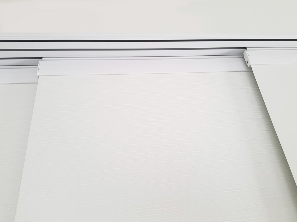 Panel Plus - Panel Glide Plus is a high quality system, exclusive to Suntex in Australia. Fabric blades are splined in to carriers, eliminating the need for the traditional Velcro or 'Hook and Loop' fastener.