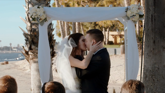 "The couple kissing after saying ""I do."""