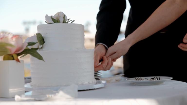 Beautiful quaint, white cake.